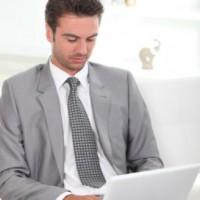 business professional using laptop: SEOLegal Law Firm Website Design Blog