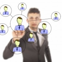 Businessman networking online: SEOLegal Social Media Blog