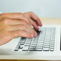 lawyer using laptop at desk: SEOLegal Law Firm Copywriting Blog