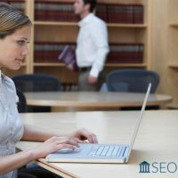 Lawyer analyzing SEO metrics of law firm