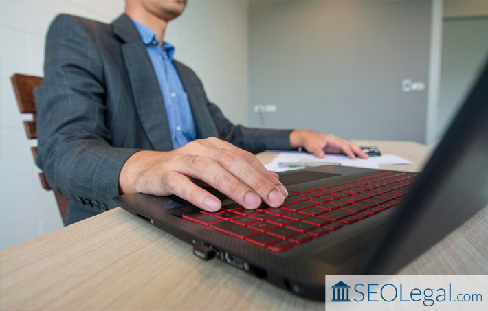 Lawyer working on law firm SEO on laptop