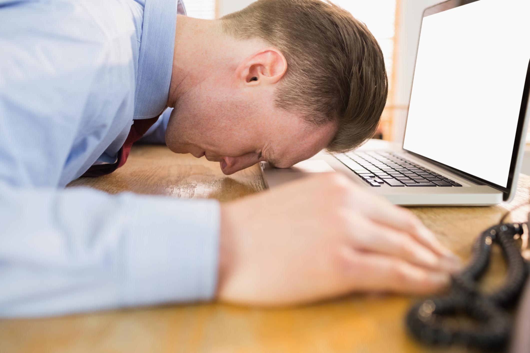 sad man on laptop computer